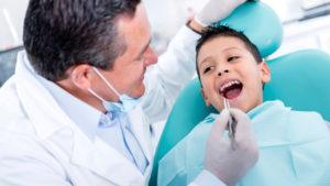 Dentist Helping Small Child